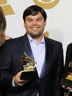 FILE - This Feb. 12, 2012 file photo shows songwriter Robert Lopez backstage with his award for best musical theater album for