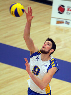 Dan Boutwell serves for the Brandon University Bobcats on Saturday night.
