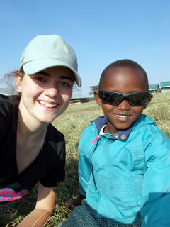 "Baldur High School student Shayla Gillis poses with Tatao — ""she was about four years old"" — in the village of Sikirrar, Kenya, in August 2013."