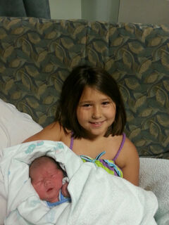 Ethan James Wayne with his sister Lori, who also possesses the recessive gene that took the newborn's life.