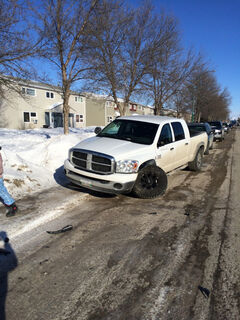 One of two pickup trucks involved in a crash Sunday afternoon.