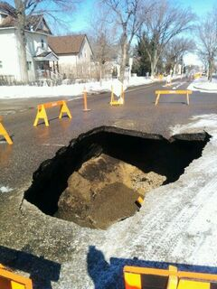 A huge sinkhole caused by a water main break has forced a portion of First Street to be closed.