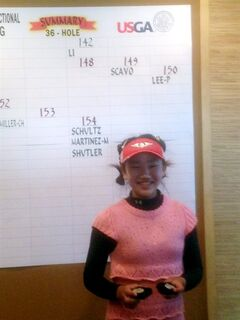 In this photo provided by the Northern California Golf Association and taken Monday, May 19, 2014, Lucy Li poses by a scoring summary and holds her medal after becoming the youngest player to qualify for the U.S. Women's Open by winning the sectional qualifier in Half Moon Bay, California. The 11-year-old Li shot rounds of 74-68 on the par-72 Old Course on Monday. She will surpass Lexi Thompson as the youngest qualifier in the U.S. Women's Open, which is June 19-22 at Pinehurst No. 2. Thompson was 12 in the 2007 Open. (AP Photo/Northern California Golf Association, Ryan Farb)