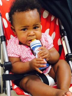 This undated image provided by the NYPD shows a baby in a stroller abandoned in a subway station in New York, Monday, July 7, 2014. New York City police say they are searching for a woman who pushed the baby's stroller onto the platform when the northbound No. 1 train arrived at the Columbus Circle station. Then she got back onto the train. (AP Photo/NYPD)