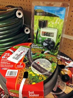 This July 2014 photo shows timers and soaker hoses, which can be used to keep your garden healthy while you're on your vacation on display in a hardware store in Larchmont, New York. (AP Photo/Julie Rubin)