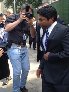 Journalists photograph Rengan Rajaratnam, right, as he exits Manhattan federal court in New York on Tuesday, July 8, 2014 after being acquitted of conspiracy to commit securities fraud. Prosecutors had alleged that Rajaratnam, 43, joined with his brother, Raj Rajaratnam, to cheat in the stock market in 2008 on the securities of two technology companies. (AP Photo/Larry Neumeister)