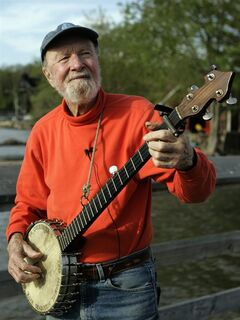 FILE - In this May 5, 2006 file photo, folk singer Pete Seeger plays his banjo in Beacon, N.Y. As what would have been his 95th birthday approaches, some wonder what would be a fitting tribute to the life of the singer/activist who was known for shunning personal accolades. (AP Photo/Frank Franklin II, File)