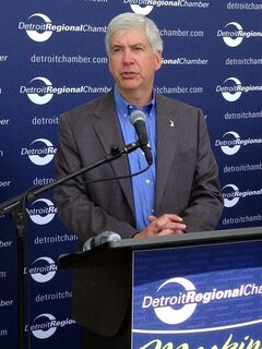 Gov. Rick Snyder speaks during the Mackinac Policy Conference, Thursday, May 29, 2014 on Mackinac Island, Mich. Snyder is urging legislators to consider updating Michigan's civil rights law to prohibit discrimination because of sexual orientation or gender identity. (AP Photo/David Eggert)