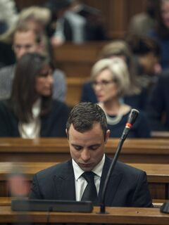 Oscar Pistorius listens to evidence in a courtroom in Pretoria, South Africa, June 30, 2014. The murder trial of Pistorius resumed Monday, after one month during which mental health experts evaluated the athlete to determine if he has an anxiety disorder that could have influenced his actions on the night he killed his girlfriend Reeva Steenkamp. (AP Photo/Ihsaan Haffejee, Pool)