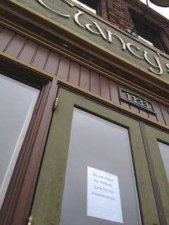 A sign posted on the front door of Clancy's Eatery and Drinkery last month, which said that the downtown establishment was closed for holidays. Corey Roberts now says the closure is permanent.