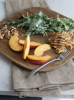 This July 21, 2014 photo shows grilled chicken paillard with peach and arugula salad in Concord, N.H. Chicken paillard serves as an alternative summer dish that is light, refreshing and substantial. (AP Photo/Matthew Mead)