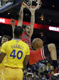 Chicago Bulls' Joakim Noah (13) scores over Golden State Warriors' Harrison Barnes during the first half of an NBA basketball game Friday, March 15, 2013, in Oakland, Calif. (AP Photo/Ben Margot)