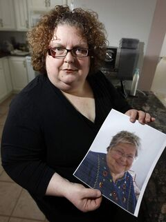 Dana Brenan holds a photo of her mother, Heather Brenan.