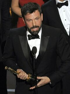 Director/producer Ben Affleck accepts the award for best picture for