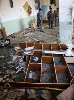 Security forces inspect damage inside the Imam Ali mosque in New Baghdad, Iraq, Monday, Aug. 25, 2014. Iraqi officials say a suicide bomber hit the Shiite mosque in eastern Baghdad, killing and wounded scores of worshipers. (AP Photo/ Khalid Mohammed)