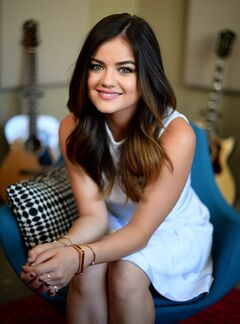 "In this Wednesday, May 14, 2014 photo, recording artist and actress Lucy Hale poses for a portrait in Burbank, Calif. Hale's debut country album ""Road Between,"" releases June 3, 2014. She will be performing at the Grand Ole Opry on June 21, 2014 in Nashville, Tenn. (Photo by Jordan Strauss/Invision/AP)"