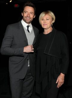 Hugh Jackman and Deborra-Lee Furness attend the DKNY 30th Anniversary fashion show during Mercedes-Benz Fashion Week on Monday, Feb. 10, 2014, in New York. (Photo by Omar Vega/Invision/AP)