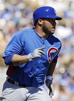 Chicago Cubs' Welington Castillo rounds first base on a two-run triple off Los Angeles Dodgers starting pitcher Chris Capuano in the first inning of a spring training baseball game Thursday, March 14, 2013, in Glendale, Ariz. (AP Photo/Mark Duncan)