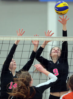 18U Westman Storm's Alison Quiring jumps to block a shot with teammate Alexis Jameson, left, during volleyball action at the BU Healthy Living Centre on Sunday.
