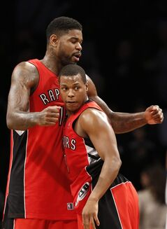 Toronto Raptors forward Amir Johnson (15) and guard Kyle Lowry (7) celebrate after the Raptors defeated the Brooklyn Nets 87-79 in Game 4 of an NBA basketball first-round playoff series at the Barclays Center, Sunday, April 27, 2014, in New York. Toronto Raptors head coach Dwane Casey used words like