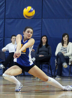 Jaryn Ruether of the Brandon Bobcats digs the ball during Conferences of Canada Challenge tournament action against the McGill Martlets at the BU gymnasium on Thursday night.