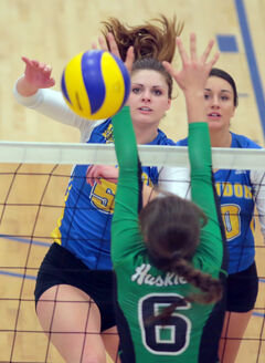 BU's Mary Thomson (right) watches Shanlee McLennan hammer a kill in CIS volleyball action.