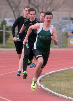 Neelin's Riley Peyachew (front) will run for the U of R Cougars.