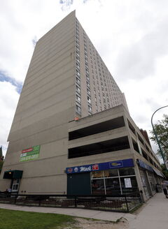 A man landed on a third-floor parkade of this Cumberland Avenue building.