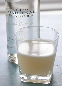 This April 28, 2014 photo shows a pisco sour made with Control original pisco premium in Concord, N.H. (AP Photo/Matthew Mead)