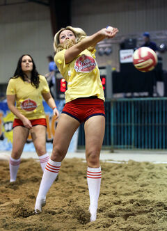 Janelle Forcand with Team Orville Redenblockers tries to dig a wild ball  during the Sun of a Beach volleyball tournament at the Keystone Centre on Friday. The tournament wraps up today with a social to follow.
