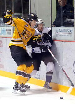 Tyler Yaworski (left) of the Brandon Wheat Kings rubs out Ryon Moser of the Swift Current Broncos on Nov. 11.