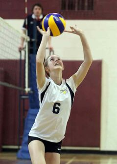 Kenzie Robinson sets for the Westman Volleyball Club 15U team Friday.