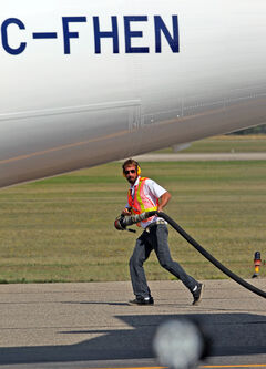 A fuelling crew member works to get a WestJet plane refuelled at the Brandon Municipal Airport. That's just one of several duties performed by the newly named Brandon Flight Centre, which has grown out of the Brandon Flying Club. The club will retain its name as one part of the organization.