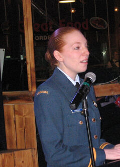 Lieut. Audra Harrison, commanding officer of 82 Brandon Squadron, reports on the year's successes to the Rotary Club of Brandon at its annual sponsorship luncheon.