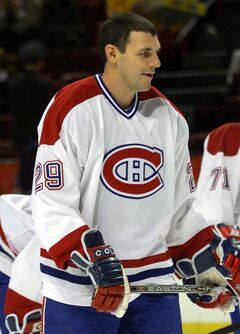 Montreal Canadiens Gino Odjick warms up before the game against the New York Rangers in Montreal on Oct. 15, 2001. Former Vancouver Canucks enforcer Gino Odjick says he has a rare terminal illness. Odjick, in a letter published Thursday on the Canucks' website, said he was diagnosed with AL (Primary) Amyloidosis two months ago.
