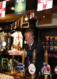 Nigel Farage, leader of Britain's United Kingdom Independence Party (UKIP) pours a pint of beer as he poses for the media at a pub in South Benfleet, England, Friday, May 23, 2014. UKIP, Britain's anti-European party has made big gains in local elections, taking votes from both the governing Conservatives and main opposition Labour Party. It's a strong performance for the U.K. Independence Party, which advocates pulling Britain out of the EU and stopping the unfettered right to entry of European citizens. With about a third of results declared Friday from voting for 161 local authorities, UKIP had almost 100 seats, well over its predicted total of 80. Britons also voted Thursday in European Parliament elections. Those results will be announced Sunday along with tallies from 27 other EU countries. (AP Photo/Lefteris Pitarakis)