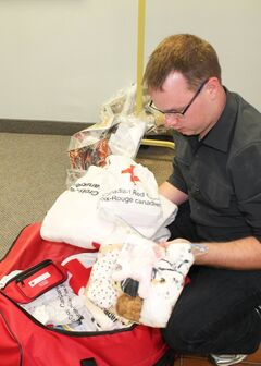 Brandon outreach coordinator, David Barker unpacks a Red Cross responder bag filled with supplies to help a family for 72 hours after a small disaster. Red Cross is launching the first Personal Disaster Assistance program in Westman.