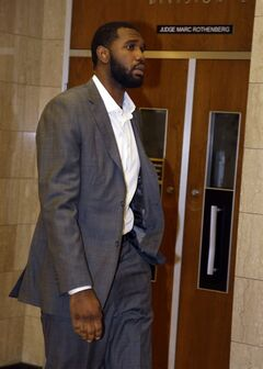 Former NBA No. 1 draft pick Greg Oden arrives for court in Indianapolis, Wednesday, Aug. 13, 2014 on charges alleging that he punched his ex-girlfriend in the face during a fight. (AP Photo/Michael Conroy)