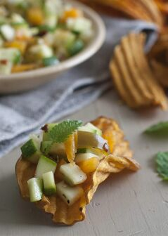 This June 30, 2014 photo shows cheesy zucchini salsa in Concord, N.H. (AP Photo/Matthew Mead)