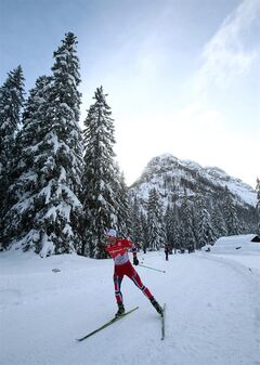 Martin Johnsrud Sundby, of Norway, skis on his way to win the men the 35-kilometer free pursuit race at the cross country Tour de Ski competition, in Dobbiaco, Italy, Friday, Jan. 3, 2014. (AP Photo/Giovanni Auletta)