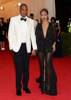 FILE - This May 5, 2014 file photo shows Jay Z, left, and Beyonce at The Metropolitan Museum of Art's Costume Institute benefit gala celebrating