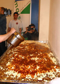 This 2004 photo shows a five-foot by seven-foot dish of poutine served in Montreal as part of the Biggest Poutine Party.