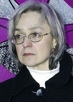 FILE - In this Oct. 2004 file photo reporter Anna Politkovskaya attends a rally against war in Chechnya in downtown Moscow, Russia. A Russian court has sentenced two men to life in prison and three others to terms ranging from 12 to 20 years for the 2006 killing of renowned journalist Anna Politkovskaya. All five were convicted last month. Politkovskaya, 48, was noted for her reporting that criticized Kremlin policies in Chechnya and human rights violations there. She was shot to death in the elevator of her Moscow apartment building.(AP Photo/Fyodor Savintsev, File)