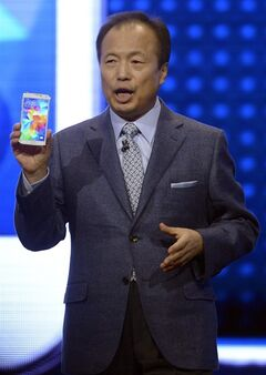 Samsung CEO J.K. Shin presents the new Samsung Galaxy S5 at the Mobile World Congress, the world's largest mobile phone trade show in Barcelona, Spain, Monday, Feb. 24, 2014. (AP Photo/Manu Fernandez)