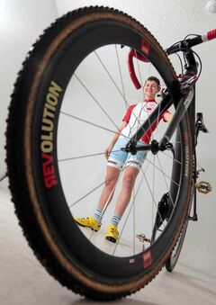 Michael van den Ham is framed by his bike during a photo shoot at the Brandon Sun on Friday.