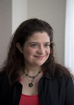 Food Network chef Alex Guarnaschelli smiles during an interview on Friday, Feb. 21, 2014 in Miami Beach, Fla.