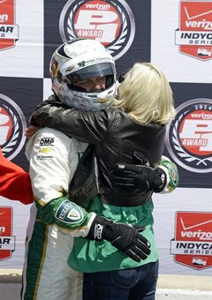 Ed Carpenter celebrates with his wife, Heather, after winning the pole during qualifications for the Indianapolis 500 IndyCar auto race at the Indianapolis Motor Speedway in Indianapolis, Sunday, May 18, 2014. (AP Photo/Michael Conroy)