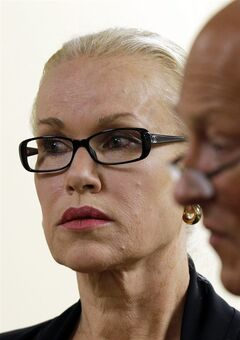 In this Friday, May 30, 2014 photo, Jean Kasem, left, the wife of ailing radio personality Casey Kasem, appears in Kitsap County Superior Court, with her attorney Joel Paget, right, in Port Orchard, Wash. A spokeswoman for the funeral service agency in the Norwegian capital says Jean Kasem has cited her Norwegian heritage as a reason for burying her late husband in Oslo. Casey Kasem, the host of