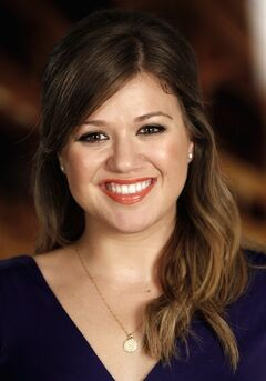 FILE - In this Sept. 22, 2011 file photo, musician Kelly Clarkson poses for a portrait in Los Angeles. The Grammy winner announced the birth of her daughter in a Saturday, June 14, 2014, post on Twitter. (AP Photo/Matt Sayles, File)