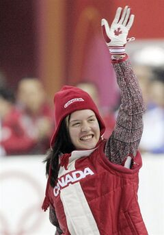 Anouk Leblanc-Boucher celebrates winning the 500-meter bronze medal in Short Track Speedskating in Turin, Italy during the 2006 Turin Winter Olympic Games on Wednesday Feb. 15, 2006. A Canadian short-track speedskater who won two medals at the 2006 Winter Games in Turin is selling her skates — and possibly one of the medals — to help finance a comeback for the 2018 Olympics.THE CANADIAN PRESS/AP Photo/Eric Gay
